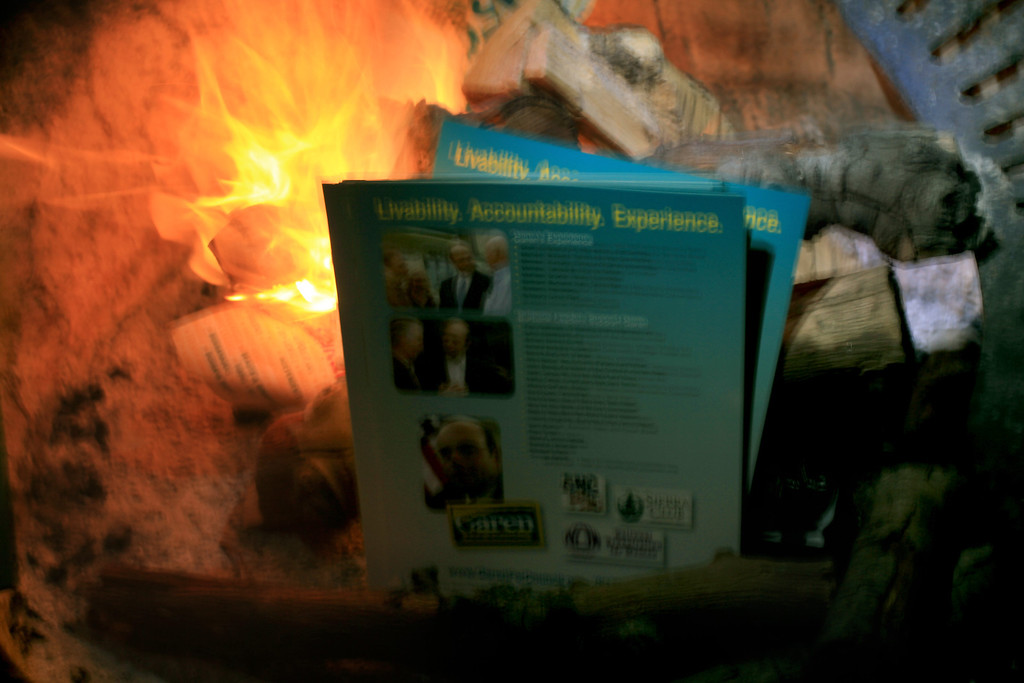 fuel for our fire... Garen's campaign literature keeping us warm while we wait the returning climbers