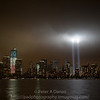 New WTC tower under construction and the 9/11 tribute lights. 09-11-11