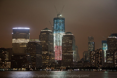 New WTC Tower under construction lit up in Red, White and Blue for the 10th anniversary of 9/11.  09-11-11