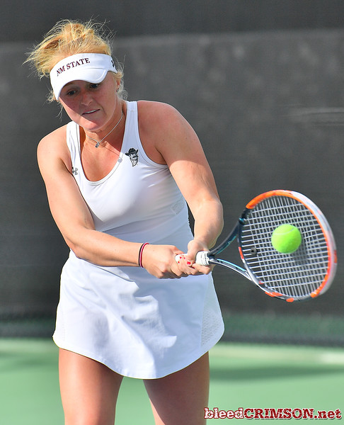 LAS VEGAS, NV - JANUARY 20:  Lindsay Harlas of the New Mexico State Aggies plays a backhand during her match against Tereza Pilzova of the Weber State Wildcats at the Frank and Vicki Fertitta Tennis Complex in Las Vegas, Nevada. Harlas won the match 4-6, 7-5, 1-0 (10-5).   Photo by Sam Wasson/bleedCrimson.net