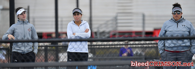 LAS VEGAS, NV - JANUARY 20:  (L-R) Helena Colvee, Yadira Rubio and head coach Emily Wang of the New Mexico State Aggies look on during a match between the New Mexico State Aggies and the Weber State Wildcats at the Frank and Vicki Fertitta Tennis Complex in Las Vegas, Nevada.  Photo by Sam Wasson/bleedCrimson.net