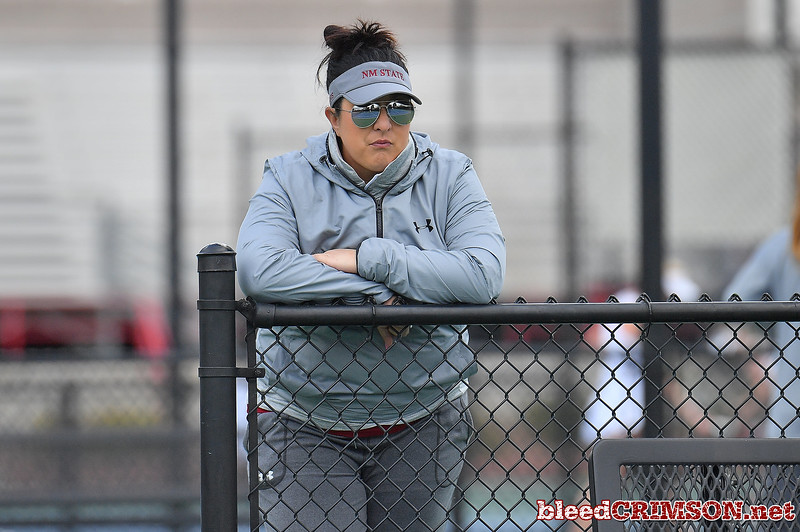 LAS VEGAS, NV - JANUARY 20:  Head coach Emily Wang of the New Mexico State Aggies looks on during a match between the New Mexico State Aggies and the Weber State Wildcats at the Frank and Vicki Fertitta Tennis Complex in Las Vegas, Nevada.  Photo by Sam Wasson/bleedCrimson.net