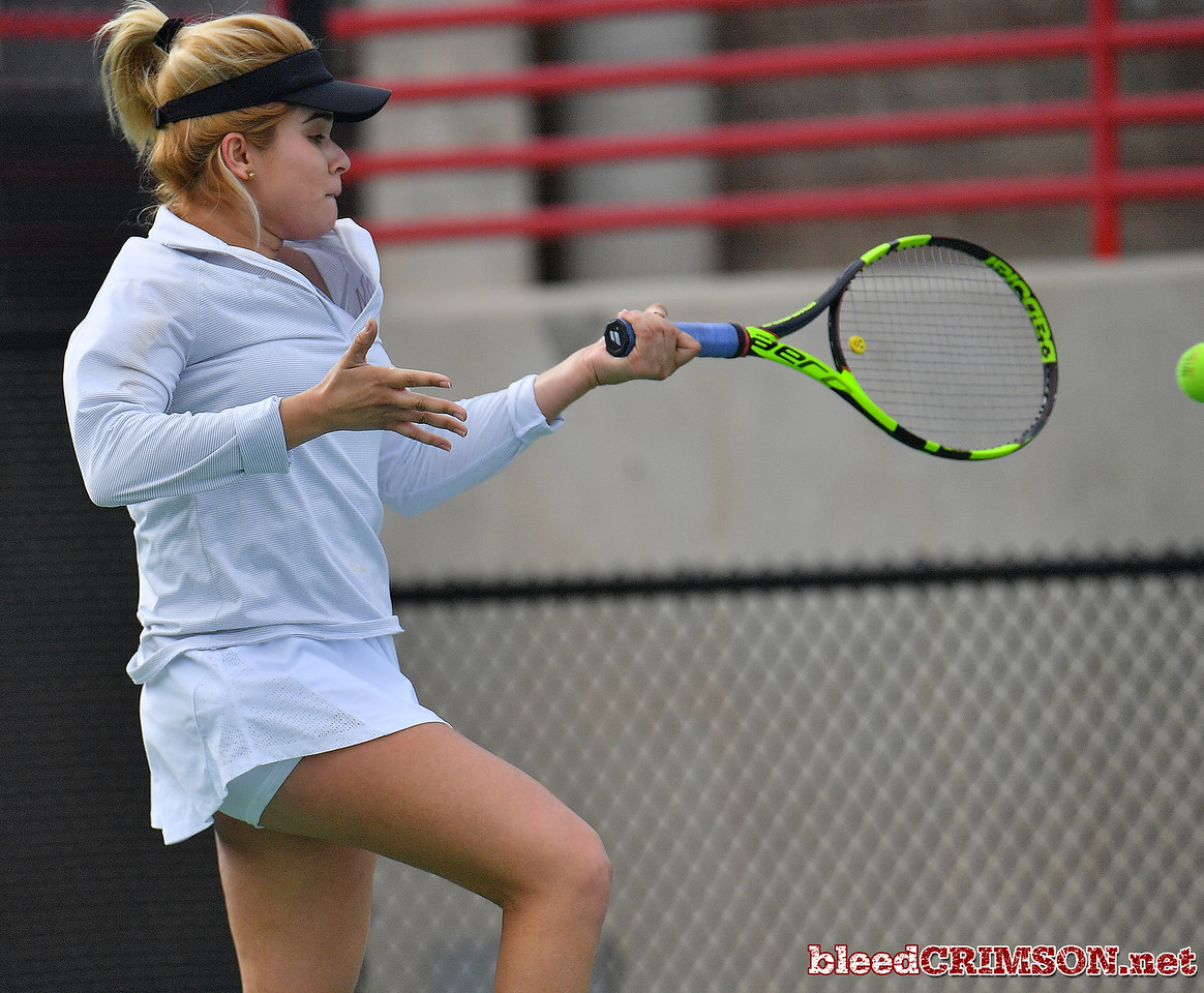 LAS VEGAS, NV - JANUARY 20:  Vanessa Valdez of the New Mexico State Aggies plays a forehand during her match against Caitlin Herb of the Weber State Wildcats at the Frank and Vicki Fertitta Tennis Complex in Las Vegas, Nevada. Herb won the match 6-4, 7-6 (10-5)  Photo by Sam Wasson/bleedCrimson.net