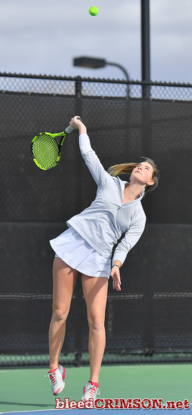 LAS VEGAS, NV - JANUARY 20:  Quinty Janssen of the New Mexico State Aggies serves during her match against Morgan Dickason of the Weber State Wildcats at the Frank and Vicki Fertitta Tennis Complex in Las Vegas, Nevada. Janssen won the match 4-6, 6-0, 6-3.  Photo by Sam Wasson/bleedCrimson.net