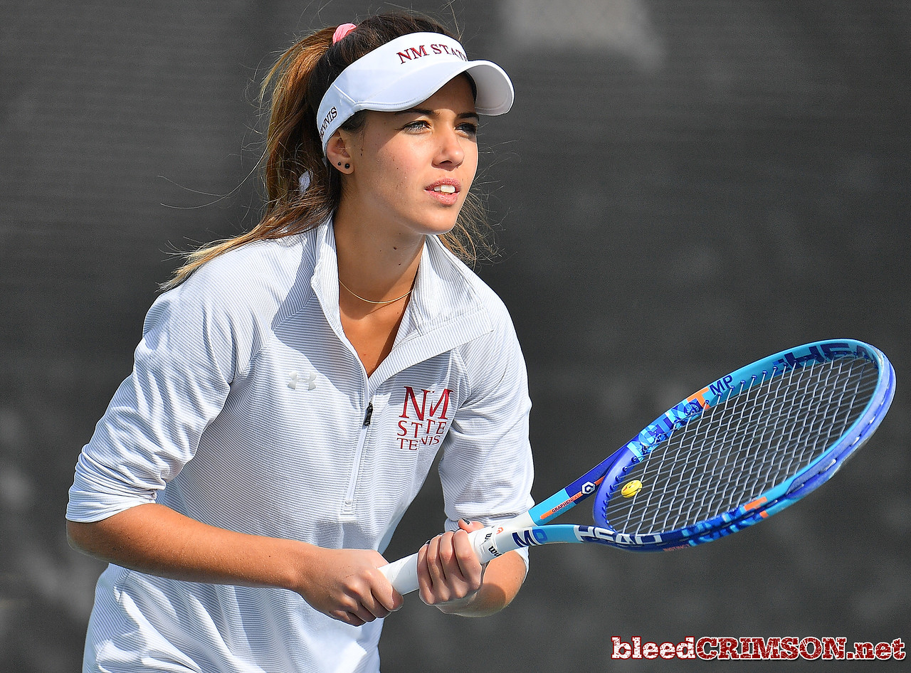 LAS VEGAS, NV - JANUARY 20:  Eli Arnaudova of the New Mexico State Aggies prepares to receive serve during her team's match against McKenna Lloyd of the Weber State Wildcats at the Frank and Vicki Fertitta Tennis Complex in Las Vegas, Nevada. Amaudova won the match 7-5, 6-2.  Photo by Sam Wasson/bleedCrimson.net