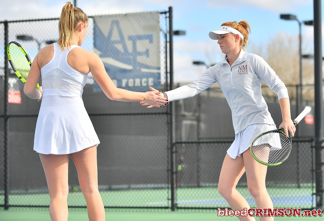 LAS VEGAS, NV - JANUARY 20:  Quinty Janssen and Rebecca Keijzerwaard of the New Mexico State Aggies celebrate after winning a point during their doubles match against McKenna Lloyd and Sara Parker of the Weber State Wildcats at the Frank and Vicki Fertitta Tennis Complex in Las Vegas, Nevada. New Mexico State won the doubles match 6-3.  Photo by Sam Wasson/bleedCrimson.net
