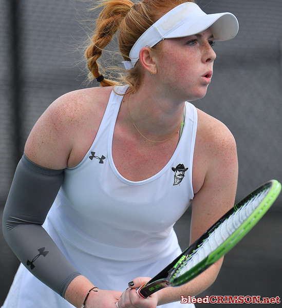 LAS VEGAS, NV - JANUARY 20:  Rebecca Keijzerwaard of the New Mexico State Aggies prepares to receive serve during her match against Pei-Hsuan (Patty) Kuo of the Weber State Wildcats at the Frank and Vicki Fertitta Tennis Complex in Las Vegas, Nevada. Kuo won the match 6-3, 7-6 (10-5),  Photo by Sam Wasson/bleedCrimson.net