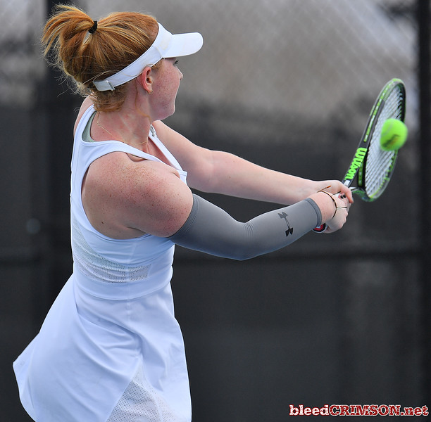 LAS VEGAS, NV - JANUARY 20:  Rebecca Keijzerwaard of the New Mexico State Aggies plays a backhand during her match against Pei-Hsuan (Patty) Kuo of the Weber State Wildcats at the Frank and Vicki Fertitta Tennis Complex in Las Vegas, Nevada. Kuo won the match 6-3, 7-6 (10-5),  Photo by Sam Wasson/bleedCrimson.net