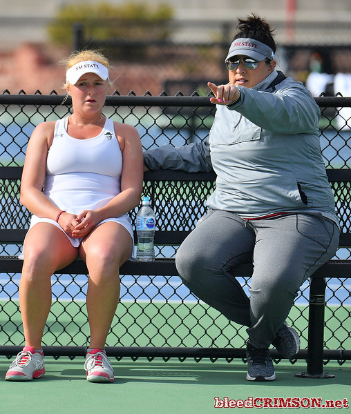 LAS VEGAS, NV - JANUARY 20:  Lindsay Harlas of the New Mexico State Aggies gets instructions from head coach Emily Wang during her match against Tereza Pilzova of the Weber State Wildcats at the Frank and Vicki Fertitta Tennis Complex in Las Vegas, Nevada. Harlas won the match 4-6, 7-5, 1-0 (10-5).  Photo by Sam Wasson/bleedCrimson.net