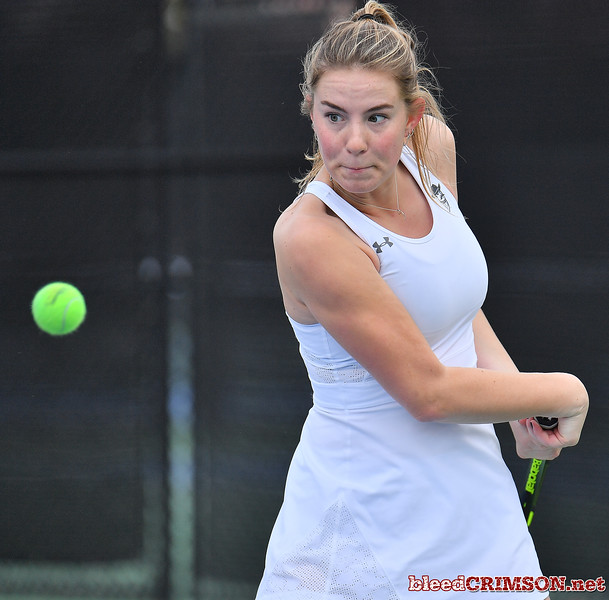 LAS VEGAS, NV - JANUARY 20:  Quinty Janssen of the New Mexico State Aggies plays a backhand during her match against Morgan Dickason of the Weber State Wildcats at the Frank and Vicki Fertitta Tennis Complex in Las Vegas, Nevada. Janssen won the match 4-6, 6-0, 6-3.  Photo by Sam Wasson/bleedCrimson.net
