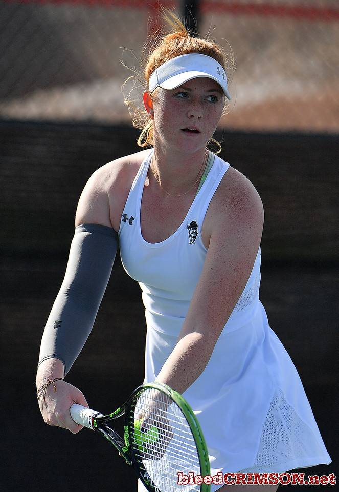 LAS VEGAS, NV - JANUARY 20:  Rebecca Keijzerwaard of the New Mexico State Aggies serves during her match against Pei-Hsuan (Patty) Kuo of the Weber State Wildcats at the Frank and Vicki Fertitta Tennis Complex in Las Vegas, Nevada. Kuo won the match 6-3, 7-6 (10-5),  Photo by Sam Wasson/bleedCrimson.net