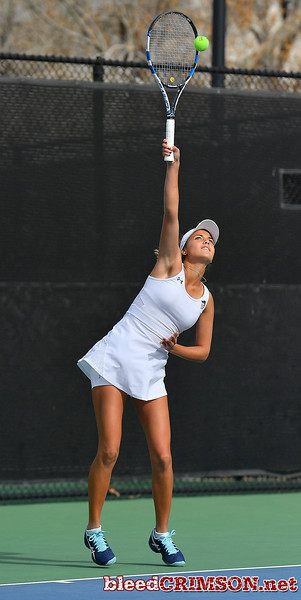 LAS VEGAS, NV - JANUARY 20:  Eli Arnaudova of the New Mexico State Aggies serves during her team's match against McKenna Lloyd of the Weber State Wildcats at the Frank and Vicki Fertitta Tennis Complex in Las Vegas, Nevada. Amaudova won the match 7-5, 6-2.  Photo by Sam Wasson/bleedCrimson.net