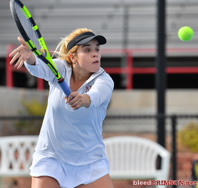 LAS VEGAS, NV - JANUARY 20:  Vanessa Valdez of the New Mexico State Aggies plays a backhand during her match against Caitlin Herb of the Weber State Wildcats at the Frank and Vicki Fertitta Tennis Complex in Las Vegas, Nevada. Herb won the match 6-4, 7-6 (10-5)  Photo by Sam Wasson/bleedCrimson.net
