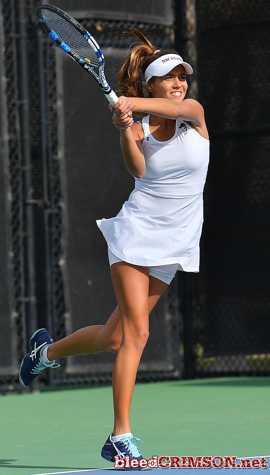 LAS VEGAS, NV - JANUARY 20:  Eli Arnaudova of the New Mexico State Aggies plays a backhand during her team's match against McKenna Lloyd of the Weber State Wildcats at the Frank and Vicki Fertitta Tennis Complex in Las Vegas, Nevada. Amaudova won the match 7-5, 6-2.  Photo by Sam Wasson/bleedCrimson.net