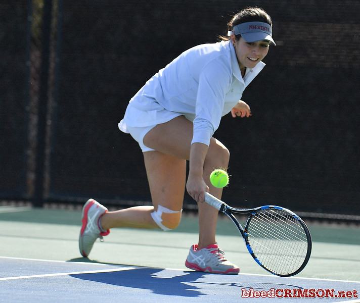 LAS VEGAS, NV - JANUARY 20:  Yadira Rubio of the New Mexico State Aggies plays a backhand during her match against Dominique Beauvais of the Weber State Wildcats at the Frank and Vicki Fertitta Tennis Complex in Las Vegas, Nevada. Rubio won the match 6-2, 6-3.  Photo by Sam Wasson/bleedCrimson.net