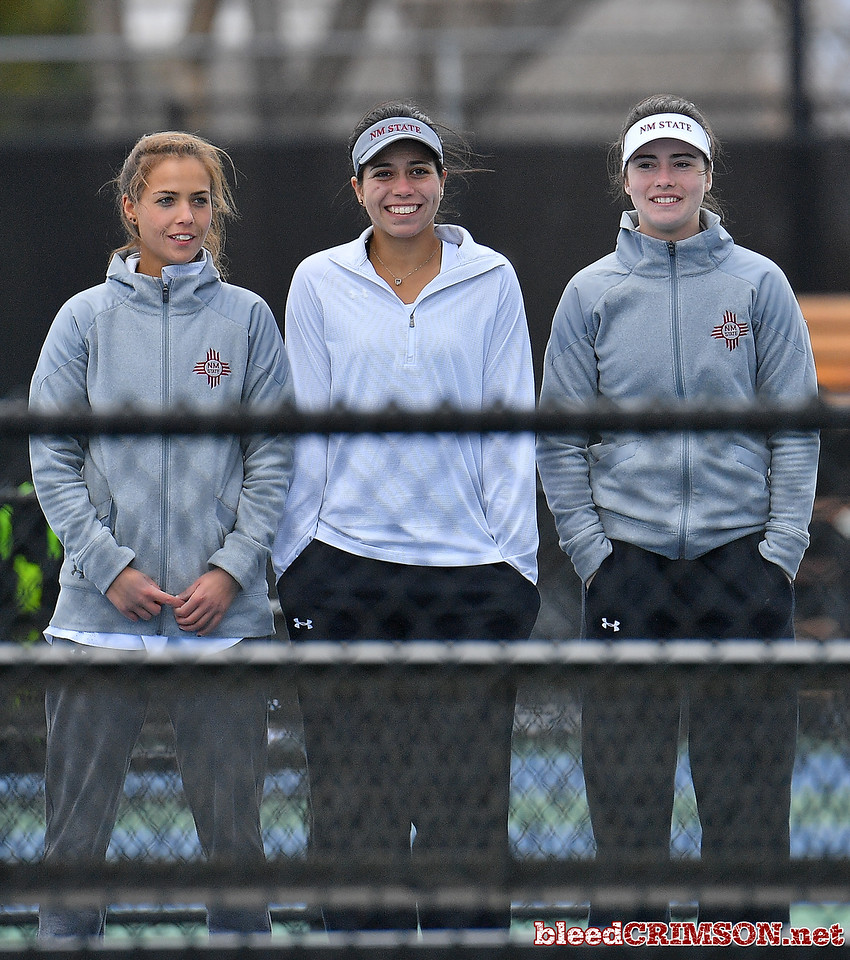LAS VEGAS, NV - JANUARY 20:  (L-R) Eli Arnaudova, Yadira Rubio and Helena Colvee of the New Mexico State Aggies look on during a match between the New Mexico State Aggies and the Weber State Wildcats at the Frank and Vicki Fertitta Tennis Complex in Las Vegas, Nevada.  Photo by Sam Wasson/bleedCrimson.net