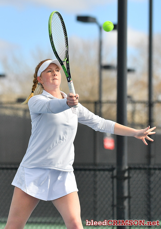 LAS VEGAS, NV - JANUARY 20:  Rebecca Keijzerwaard of the New Mexico State Aggies plays a forehand during her team's doubles match against McKenna Lloyd and Sara Parker of the Weber State Wildcats at the Frank and Vicki Fertitta Tennis Complex in Las Vegas, Nevada. New Mexico State won the doubles match 6-3.  Photo by Sam Wasson/bleedCrimson.net