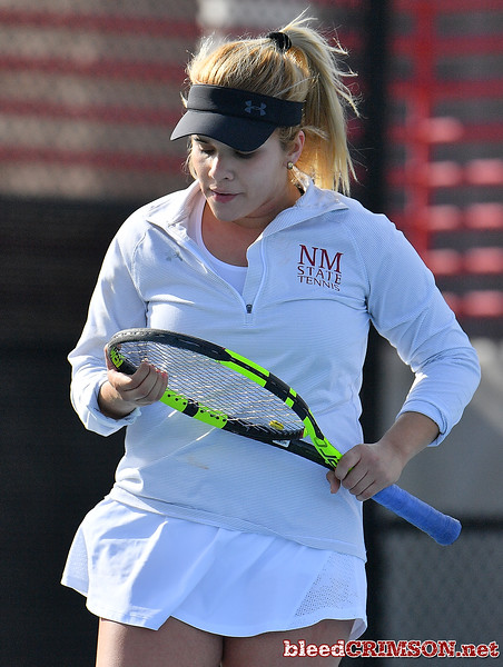LAS VEGAS, NV - JANUARY 20:  Vanessa Valdez of the New Mexico State Aggies reacts after losing a point during her match against Caitlin Herb of the Weber State Wildcats at the Frank and Vicki Fertitta Tennis Complex in Las Vegas, Nevada. Herb won the match 6-4, 7-6 (10-5)  Photo by Sam Wasson/bleedCrimson.net