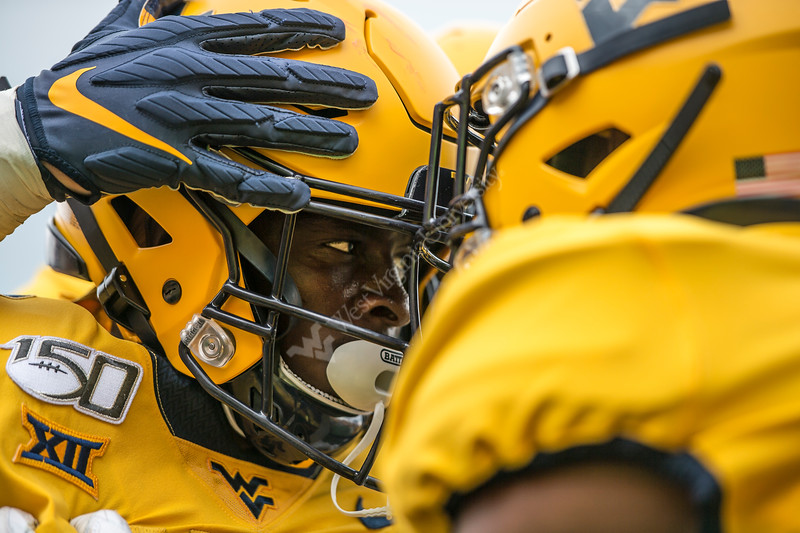 Two players, helmet to helmet, after a touchdown. WVU's football team faced off against NC State on September 14, 2019. (WVU Photo/Parker Sheppard)