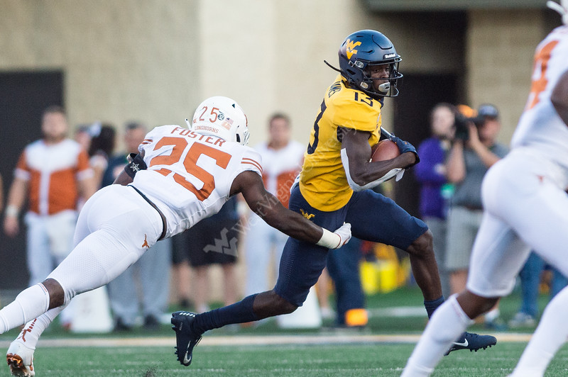 Wide Receiver Sam James maneuvers through the Texan's defensive line  on October 5, 2019. The crowd striped the stadium with blue and gold and the 2019 Homecoming King and Queen was announced on this day the the Milan Puskar Stadium. (WVU Photo/ Hunter Tankersley)