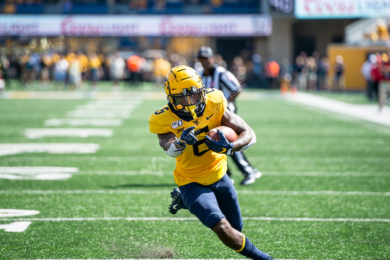 Kennedy McKoy points as he runs into the endzone. WVU's football team faced off against NC State on September 14, 2019. (WVU Photo/Parker Sheppard)