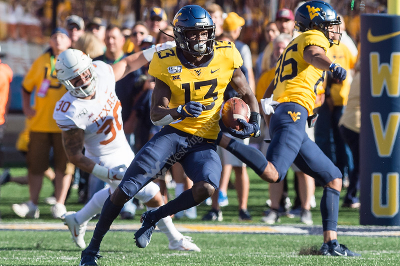 Wide Receiver Sam James darts past Texan's defensive line on October 5, 2019. The crowd striped the stadium with blue and gold and the 2019 Homecoming King and Queen was announced on this day the the Milan Puskar Stadium. (WVU Photo/ Hunter Tankersley)