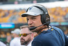WVU Mountaineers Heach Coach Neal Brown adjusts his headset prior to the start of the game versus the NC State Wolfpack at Mountaineer Field September 14th, 2019.  (WVU Photo/Brian Persinger)
