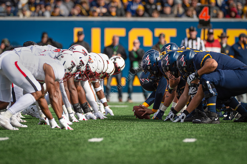 Players of the Texas Tech and WVU teams get in formation. WVU Football challenged Texas Tech at Milan Puskar Stadium on November 9, 2019. The football game also hosted the announcement of the Most Loyal awards and the Mr. and Ms. Mountaineer awards at halftime. (WVU Photo/Hunter Tankersley)
