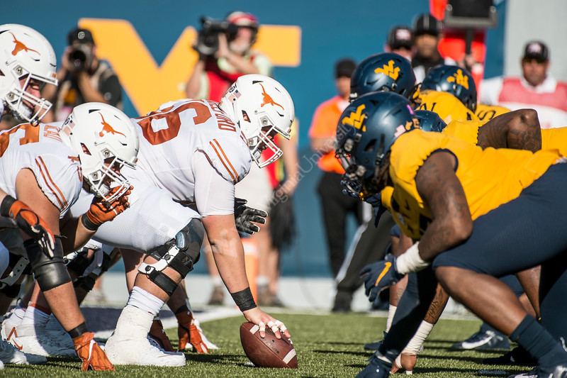 WVU's defense lines up against Texas waiting for the snap. WVU Football faced off against Texas at Mountaineer Field October 5, 2019. (WVU Photo/Parker Sheppard)