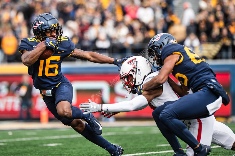 Wide receiver Winston Wright narrowly escapes the grasp of a Texas Tech defensive player. WVU Football challenged Texas Tech at Milan Puskar Stadium on November 9, 2019. The football game also hosted the announcement of the Most Loyal awards and the Mr. and Ms. Mountaineer awards at halftime. (WVU Photo/Hunter Tankersley)
