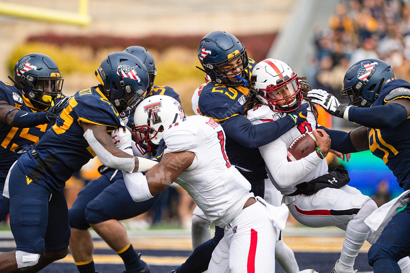 WVU's defensive line challenges Texas Tech with a strong opposition. WVU Football challenged Texas Tech at Milan Puskar Stadium on November 9, 2019. The football game also hosted the announcement of the Most Loyal awards and the Mr. and Ms. Mountaineer awards at halftime. (WVU Photo/Hunter Tankersley)