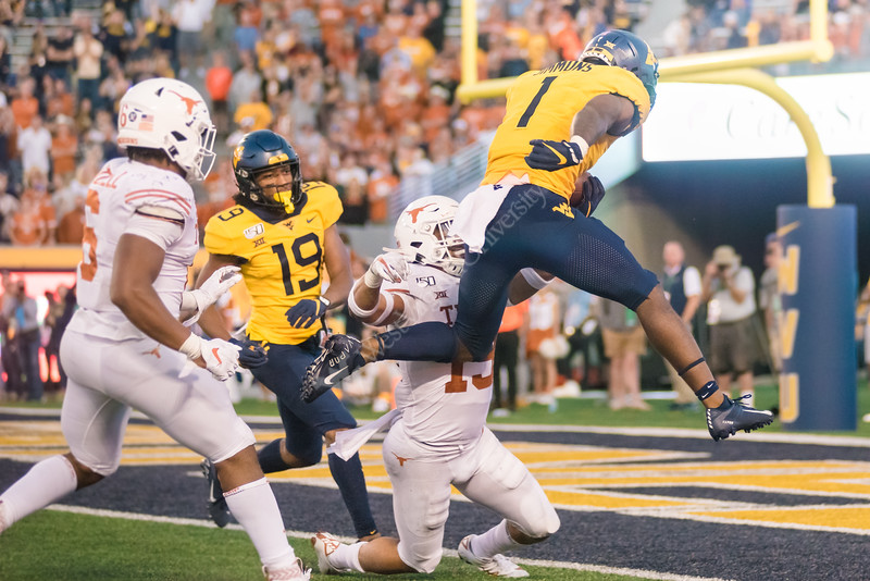 Wide Receiver T.J. Simmons crosses over into touchdown territory at the WVU VS Texas Football Game on October 5, 2019. The crowd striped the stadium with blue and gold and the 2019 Homecoming King and Queen was announced on this day the the Milan Puskar Stadium. (WVU Photo/ Hunter Tankersley)