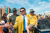 Neal Brown shaking hands with son while entering Mountaineer Field. WVU Football faced off against Texas at Mountaineer Field October 5, 2019. (WVU Photo/Parker Sheppard)