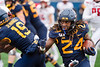 Running Back Tony Mathis runs toward an opening offensive line while wide receiver Ali Jennings holds the opposition back. WVU Football challenged Texas Tech at Milan Puskar Stadium on November 9, 2019. The football game also hosted the announcement of the Most Loyal awards and the Mr. and Ms. Mountaineer awards at halftime. (WVU Photo/Hunter Tankersley)