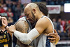 Senior guards Jevon Carter and Daxter Miles Jr. embrace following their last game in the Coliseum. The Mountaineers defeated Texas Tech 84 - 74.