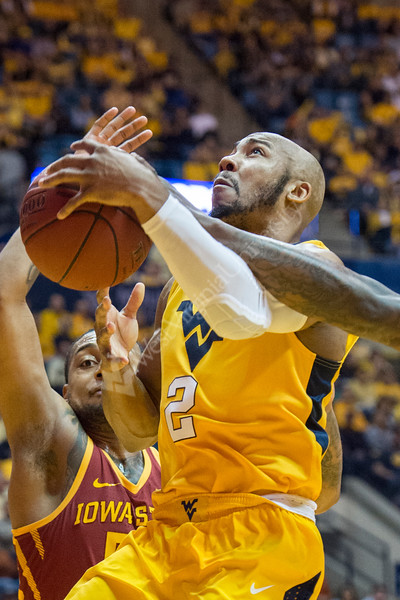 Jevon Carter goes up for a layup and is contested at the rim against Iowa State at the Coliseum on February 24, 2018. The mountaineers went on to win the game.