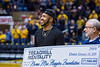 Jevon Carter presents a check to the Norma Mae Huggins Foundation while returning to WVU. Jevon now plays for the Memphis Grizzlies.