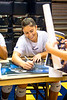 Gabriella Cuckovich signs a poster after the game. WVU Volleyball took on Texas Tech in the Coliseum November 16, 2019. (WVU Photo/Parker Sheppard)