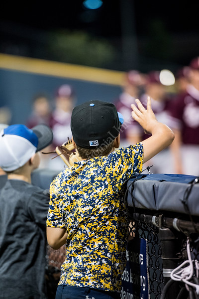 Young WVU fan stands at the fence during the team's first game of the NCAA Regional on May 31, 2019 at Monongalia County Ballpark. Photo Parker Sheppard