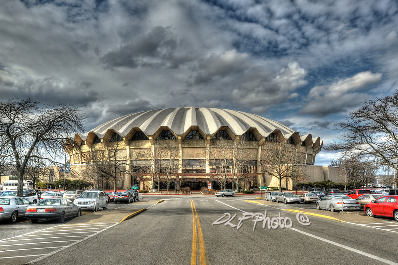 "to purchase - <a href=""http://bit.ly/X9HDoY"">http://bit.ly/X9HDoY</a><br /> <br /> The WVU Coliseum is a 14,000-seat multi-purpose arena which is located in the Evansdale campus of West Virginia University in Morgantown, West Virginia. The circular arena features a poured concrete roof. The arena, which opened in 1970, is home to the WVU Mountaineers men's and women's basketball teams, men's wrestling, as well as WVU's women's teams in volleyball and gymnastics"