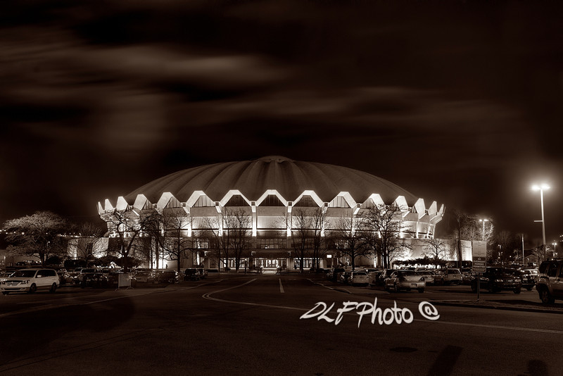 """To purchase - <a href=""""http://dan-friend.artistwebsites.com/galleries.html"""">http://dan-friend.artistwebsites.com/galleries.html</a><br /> <br /> The WVU Coliseum is a 14,000-seat multi-purpose arena which is located in the Evansdale campus of West Virginia University in Morgantown, West Virginia. The circular arena features a poured concrete roof. The arena, which opened in 1970, is home to the WVU Mountaineers men's and women's basketball teams, men's wrestling, as well as WVU's women's teams in volleyball and gymnastics"""