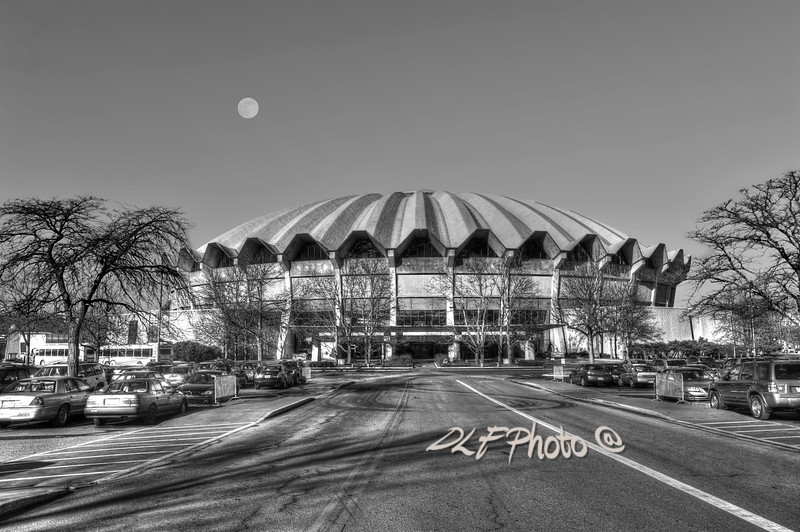 "To purchase - <a href=""http://dan-friend.artistwebsites.com/galleries.html"">http://dan-friend.artistwebsites.com/galleries.html</a><br /> <br /> The WVU Coliseum is a 14,000-seat multi-purpose arena which is located in the Evansdale campus of West Virginia University in Morgantown, West Virginia. The circular arena features a poured concrete roof. The arena, which opened in 1970, is home to the WVU Mountaineers men's and women's basketball teams, men's wrestling, as well as WVU's women's teams in volleyball and gymnastics"