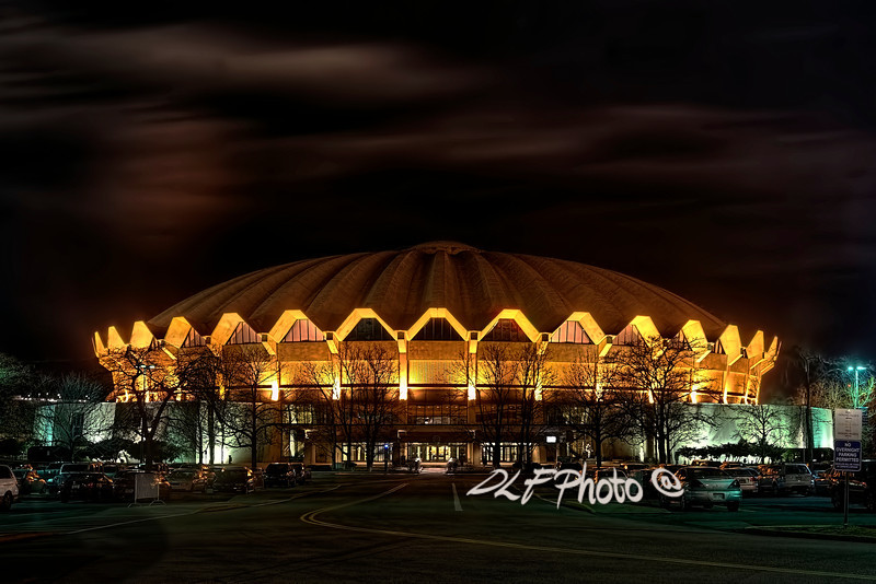 "To purchase - <a href=""http://dan-friend.artistwebsites.com/galleries.html"">http://dan-friend.artistwebsites.com/galleries.html</a><br /> <br /> <br /> The WVU Coliseum is a 14,000-seat multi-purpose arena which is located in the Evansdale campus of West Virginia University in Morgantown, West Virginia. The circular arena features a poured concrete roof. The arena, which opened in 1970, is home to the WVU Mountaineers men's and women's basketball teams, men's wrestling, as well as WVU's women's teams in volleyball and gymnastics"
