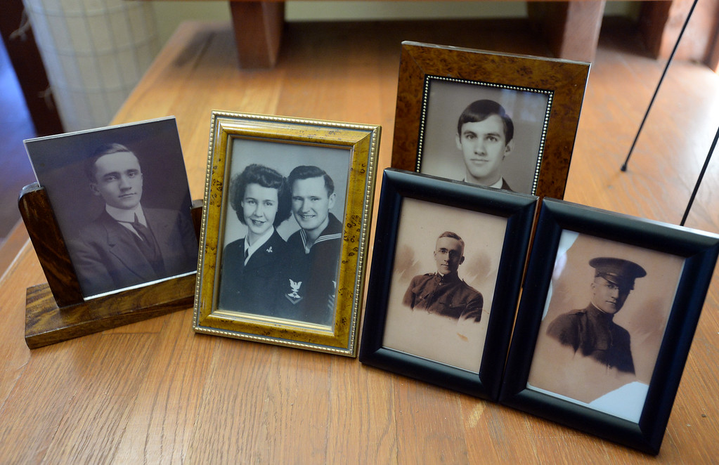 . BOULDER, CO - November 9, 2018: A photo of Walter Young\'s grandfather, Bradford Hathaway, left, Young\'s parents in WWII, Harriet and Warren Young, Young himself, and two photos of Hathaway from WWI.  (Photo by Cliff Grassmick/Staff Photographer)