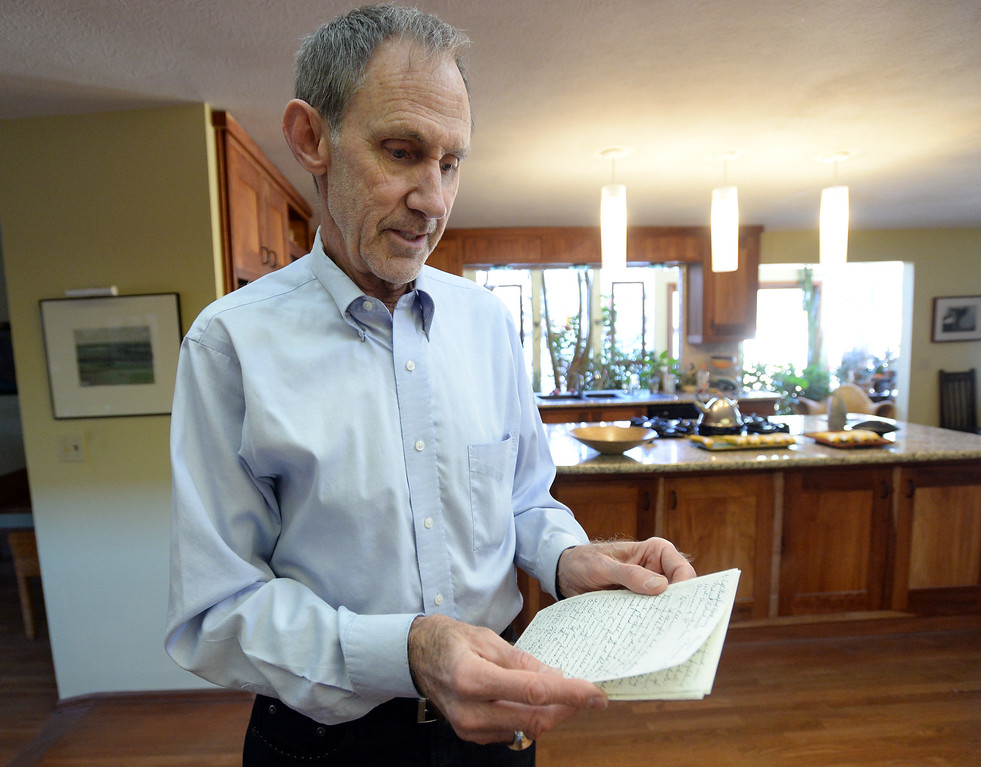 . BOULDER, CO - November 9, 2018: Walter Young, of Boulder, holds a letter written by his grandfather, Bradford Hathaway, written100-years ago while he was serving in WWI in France.  (Photo by Cliff Grassmick/Staff Photographer)