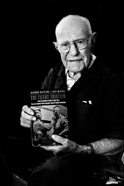 "Legendary Jake McNiece, paratrooper in the 506th, 101st Airborne division and founder of what became known as the ""Filthy Thirteen"". Jake made an unheard of 4 combat jumps. During his Army career he was constantly in trouble, so much so that regardless of the fact that he was in charge of men on the ground and technically an acting Sergeant, was pivotal in these campaigns, and earned numerous awards and medals,  never made it past Buck Private, something  he is still very proud of. <br /> <br /> A paratrooper (demolition/saboteur) had one of the most dangerous jobs in the Army, in fact so dangerous that initially it was all voluntary. The Army estimated that the average life span of a paratrooper was one and a half jumps, or 50% casualties. That's because for the most part when they were jumping out of those planes, they were being shot at from the ground. Jake said their unit actually experienced up to 70% casualties. When he was in the Pathfinders they had a casualty rate of 80%. The Army would put ten men in a ""stick"" as Jake liked to call it, because they figured they would lose 8 of the men which would leave 2 to do the job efficiently.  <br /> <br /> The picture on the front of the Filthy Thirteen book, taken the day before the D-Day drop, immortalized Jake and his unit and spawned inacurate stories from ""a band of dirty Indians"", ""convicts"", and even as far as a movie being made titled ""Dirty Dozen."" For the record, none of that information is correct. The only one who was close to Indian was Jake who has Indian ancestry, and none were convicts. The movie was highly inaccurate mostly because Jake refused to endorse the movie as he didn't want to earn blood money on his dead comrades.  Hollywood in its usual manner created its own war story sprinkled with a few facts.<br /> <br /> True to Jake's antics and constant wild ideas and behavior, the reason for the mohawk was simple. If Jake was going to fight in this war he was going to make the best of it. Coming from Oklahoma Jake figured that if Indians painted their faces before going into battle, he could to. Thus, shaved his head and put war paint on. One can imagine that this must have also helped with the anxiety of the men who within hours may or may not be alive.<br /> <br /> * ref: ""The Filthy Thirteen"" by Richard Killblane & Jake McNiece, and personal conversation with Jake, 2010."