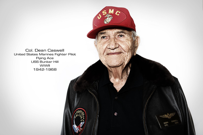 During WWII, Col. Dean Caswell, then a 1st Lt., served in the US Marine Corp Reserve as a pilot flying USMC Corsairs in the Marine Fighting Squadron VMF221. Caswell was attached to the USS Bunker Hill which sustained heavy damage due to an aerial battle  with Japanese Kamikaze's. Caswell flew over 100 missions and became a WWII flying Marine Corp ACE having been credited with shooting down seven enemy aircraft in aerial combat in the Pacific theater. He would continue to serve during the Korean war and a portion of the Vietnam war.