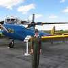 Sharon in her Navy Nurse flight suit in front of a PT-19 Army trainer.
