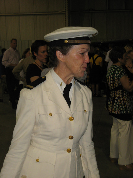 Sharon in deep conversation. Everyone stopped her to ask about her uniform; an original 1940 -42 Navy Nurse uniform, original owner was Lt. Carmel Gallo. The shoulder boards are assistant chief nurse (ensign) rank and are age appropriate to the uniform (no star) . The boards and buttons are from a nurse Joanne Jenson.