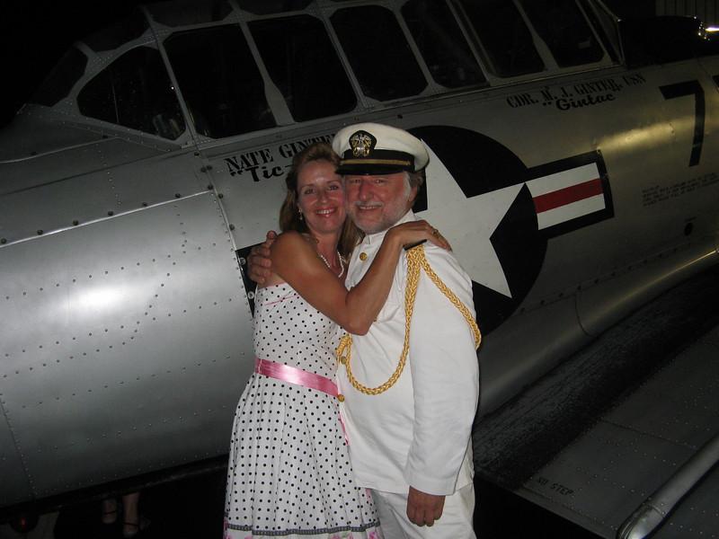 Being an officer and a gentleman. A Navy uniform always does it!  Its tough duty. Her boyfriend made me do it, honest.